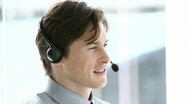 Charming businessman working in a call center Stock Footage