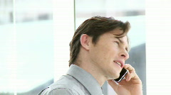 Positive businessman talking on phone Stock Footage