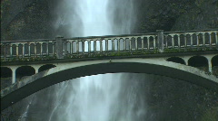 Waterfall behind bridge Stock Footage