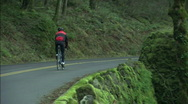 Cyclist on a mountain road Stock Footage