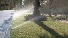 Desert landscape lawn sprinkler 001 - stock footage