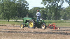 Stock Video Footage of Pioneer diesel tractor plowing 001