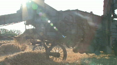 Threshing machine sunrise - stock footage