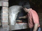 Stock Video Footage of Argentina-Cooking-Stone-Fireplace