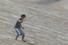 Brazil-Florianopolis-Sand-Surfing-Wipeout Stock Footage