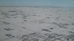 Aerial flight over great plains in winter - stock footage