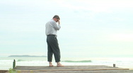 Stock Video Footage of Depressed businessman at the sea