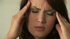 Stock Video Footage of HD1080i Young woman having headache and massaging her head