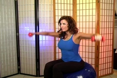 Beautiful Brunette Working Out with Hand Weights (4) Stock Footage