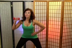 Beautiful Brunette Working Out with a Hand Weight Stock Footage