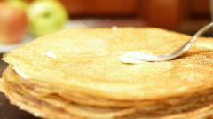 Female hand oils pancakes. Stock Footage