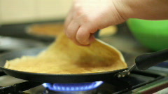 Preparation of pancakes on frying pan. Stock Footage