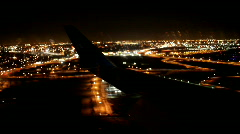 Wing View of airplane landing at Night Stock Footage