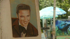 Elvis painting on the mall, outdoors Stock Footage