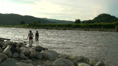 2 women in river - stock footage