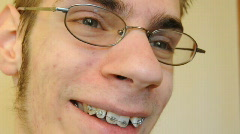 Smiling teen with braces Stock Footage