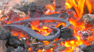 Stock Video Footage of HD Glowing iron pattern ready for blacksmith, closeup