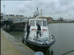 Police patrol in Antwerp harbour Stock Footage