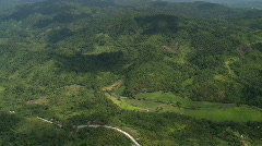 Aerial of cemented road through the jungle Stock Footage