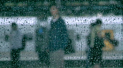 Man At Train Station in Rain - stock footage