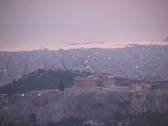 Stock Video Footage of Telephoto of the Parthenon atop the acropolis at dusk with sea in background in