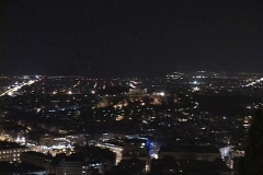 Night zoom into lit Parthenon atop the acropolis in Athens, Greece Stock Footage