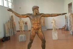 Bronze, classical statue of the Greek god Zeus or Poseidon, crane Stock Footage