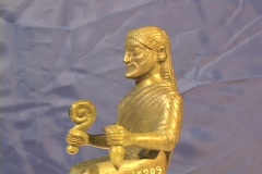 Bronze statuette of the Greek god Zeus seated on his throne atop Mt. Olympus Stock Footage