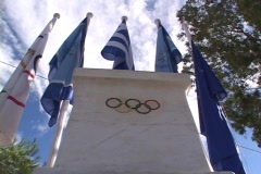 Modern Olympics rings/flags monument at Marathon, Greece Stock Footage