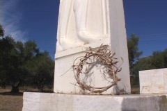 Crown wreath at base of Marathon fighters memorial tomb at Marathon, Greece Stock Footage