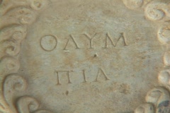 "Marble relief sculpture showing ""Olympia"" in Greek lettering - stock footage"