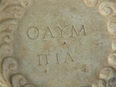 "Stock Video Footage of Marble relief sculpture showing ""Olympia"" in Greek lettering"