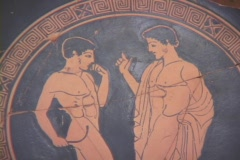 Red figure ceramic plate depicting nude athlete with sturgil and coach/judge Stock Footage