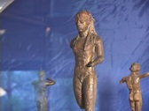 Archaic bronze statuette of running athlete Stock Footage