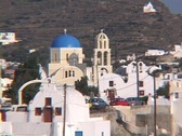 White washed buildings and churches in the village of Oia on the Greek island of Stock Footage