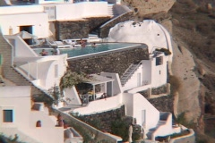 Luxury hotel accomodations and pools in the village Oia on the Greek island of Stock Footage