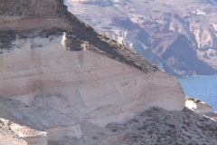 The volcanic caldera and pumice layered cliffs on the Greek Islands of Stock Footage