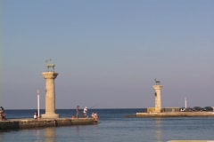 The deer-topped columns astride the entrance of Rhodes harbor on the Greek Stock Footage
