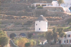 White washed windmill on the Greek island of Mykonos, Greece Stock Footage