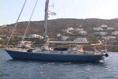 Sailboat at anchor on the Greek island of Mykonos, Greece Stock Footage