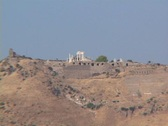Stock Video Footage of Telephoto zoom out from Temple of Trajan to the Asclepion at Pergamum (modern