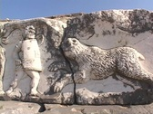 Stock Video Footage of Marble relief sculpture of lion and gladiators at Miletus (modern day Turkey)
