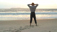 Stock Video Footage of Businessman enjoying the sun on a beach