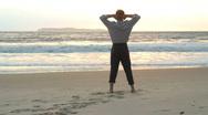 Stock Video Footage of Businessman enjoying the sun on a beach