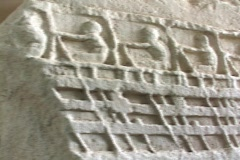 Marble relief sculpture depicting sailors rowing on an ancient ship (Trireme?) Stock Footage