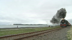 steam train races along coast(with sound) - stock footage