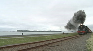 Steam train races along coast(with sound) Stock Footage
