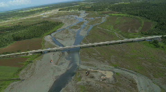 Aerial of huge concrete bridge over a river with low water level Stock Footage