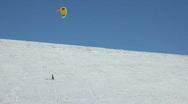 Snowkite high on mountain P HD 6291 Stock Footage