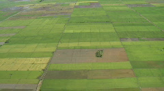 Aerial over rural fields with a river going right through - stock footage